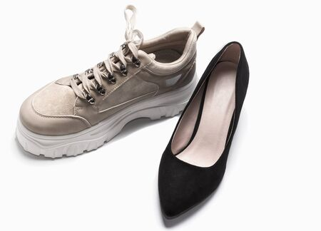 the concept of comparing elegant shoes against comfortable sneakers. Imagens - 135478317