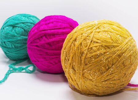 A set of three colored balls of yarn for knitting on white background. Imagens - 135478331