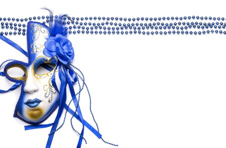 the beads are lined in even rows and the Mardi Gras mask is blue on a white background