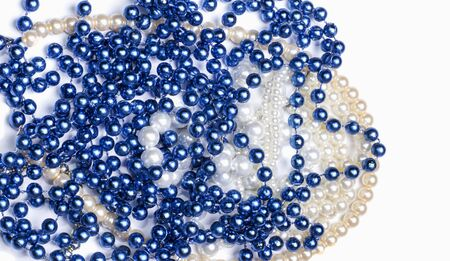 a bunch of blue and white beads on a white background
