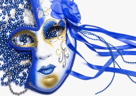 bouquet of blue and white beads and mask on white background