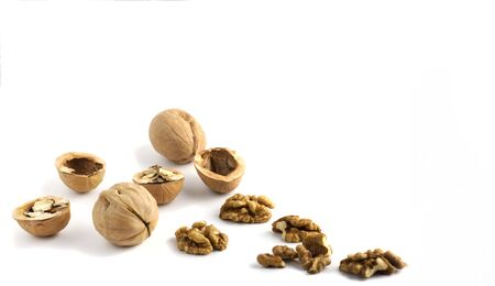 nuts with walnut shell and kernel with copy space on white background.