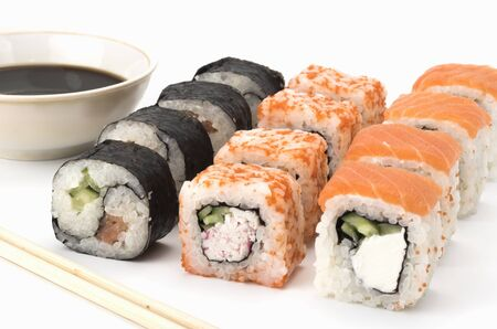 sushi roll with salmon, shrimp, avocado cream cheese. on white background. Japanese cuisine