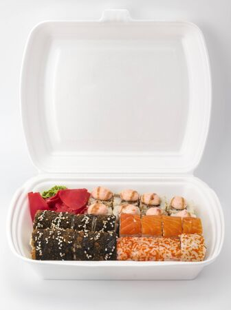 Sushi delivery at home .many kinds of sushi in the package Imagens