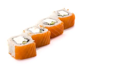 Delicious fresh sushi rolls with salmon and Philadelphia cheese on white background. Imagens