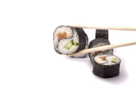 Yin Yang Maki sushi on sticks isolated on white background.