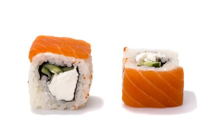 two delicious fresh sushi rolls with salmon and Philadelphia cheese on a white background.