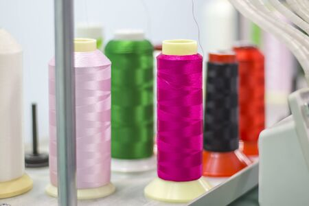 bright colors of embroidery threads on a modern embroidery machine.