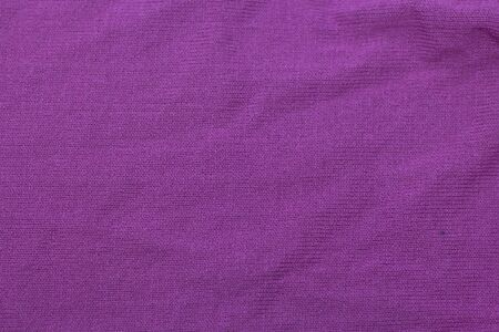 texture of purple wool knitted fabric as background.