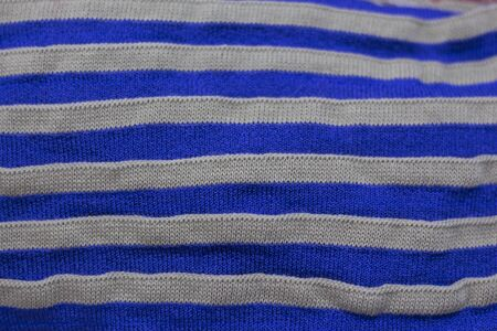 striped texture of knitted fabric as a background. Imagens