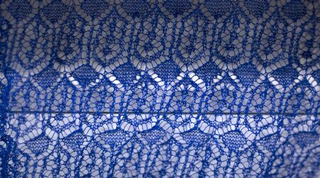 texture blue viscose openwork fabric as background. Imagens