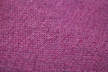 texture of pink wool knitted fabric as background.