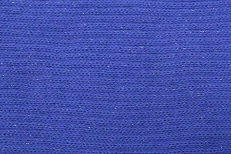 blue melange texture with sequins knitted fabric as background.