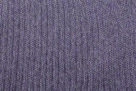 blue lilac texture with sequins knitted fabric as background.