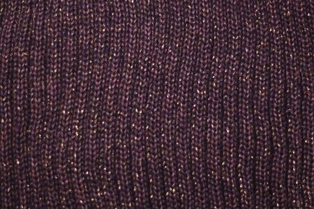 brown texture with sequins and knitted fabric as the background. Stockfoto