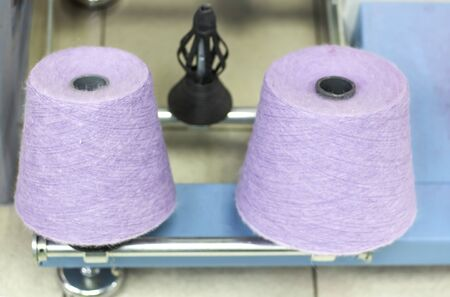 lilac thread on a modern machine for twisting threads in production.