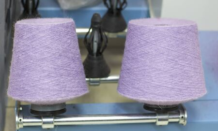 two Babin lilac threads on a modern machine for twisting threads in production. Imagens