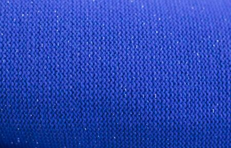 blue wool knitted fabric texture as background.