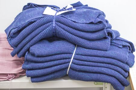 knitted parts bound on a modern knitting machine in production are waiting for further processing.