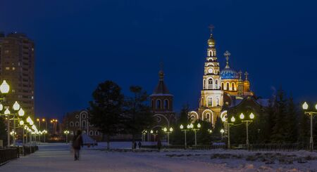 View of the Orthodox Church of the night city. Panorama of night lights of the city.