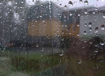 outside the window is raining heavily, raindrops on the window.