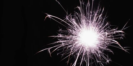 bright festive new year Sparkler close up on a black background with a copy of the space. Imagens