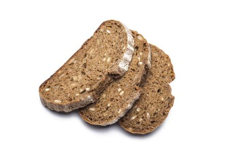 three pieces of black bread with sunflower seeds on a white background.