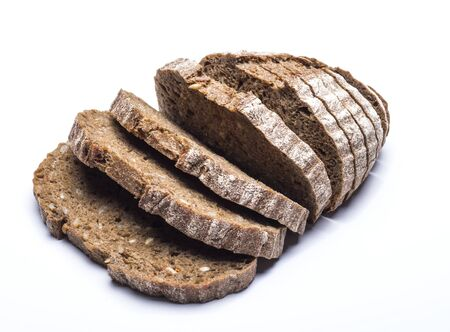 slices of black whole grain farm bread on a white background.