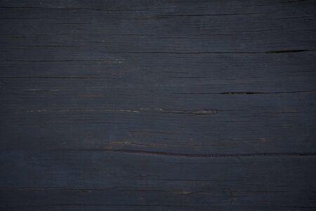 a black background of smoke-blackened oak planks