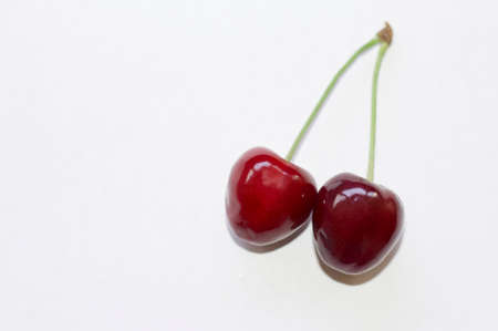 two cherries on a white background with a copy of the space 免版税图像