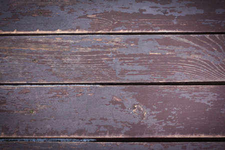Rustic wooden background with snow, top view