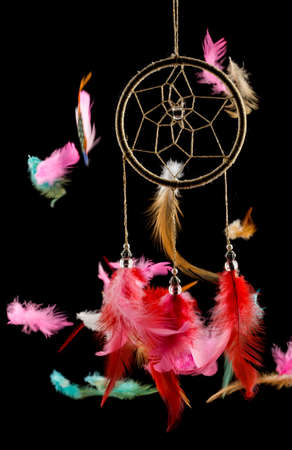 Beautiful dream catcher with flying feathers on black