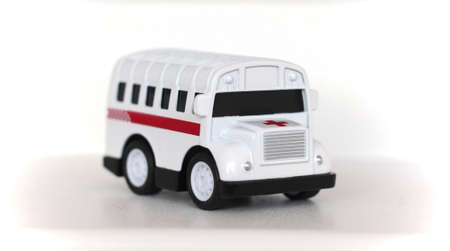 toy in the form of a medical ambulance on a white background