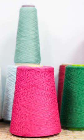 Multi-colored yarn spools for knitting and mending fabrics