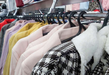 Department for the sale of outerwear, womens coats on hangers