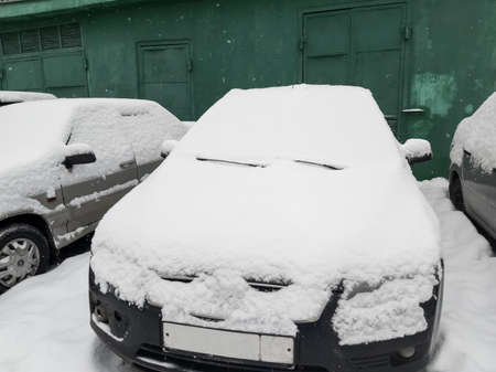 cars parked near the house were hit by snow