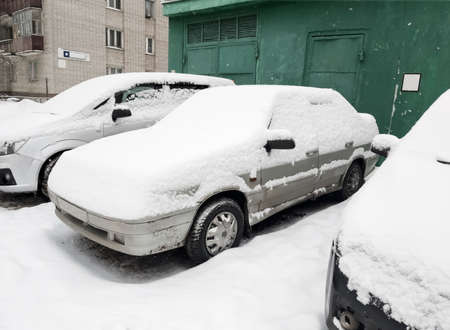 winter weather cars parked near the house were hit by snow