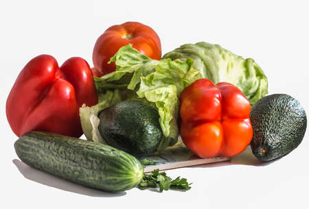 various vegetables, avocado with cucumber and parsley, bell pepper and tomato