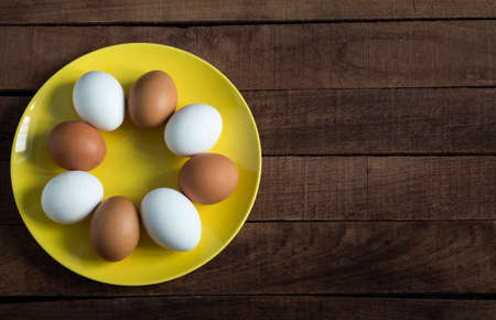 a plate full of raw whole chicken eggs for making fresh homemade food with a copy of the space