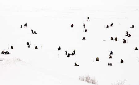 Novocheboksarsk,Russia-February 27, 2021:rybak rybak festival, fishing on the frozen river