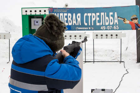 Russia, Novocheboksarsk,27 February 2021:a woman fires a rifle at targets