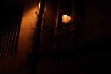 floor lamp reflection on a broken window Stockfoto