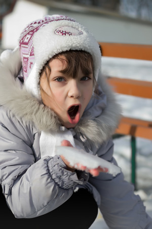 simulate: young girl is simulate snow eating