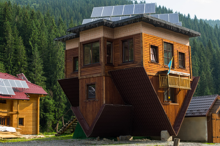 al reves: Bukovel, Carpathians, Ukraine, July 8,2014-Unusual house upside down