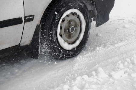 skids: Car tire skids on slippery road