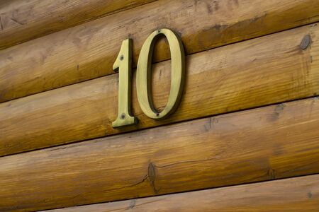number ten: House number ten on a wooden wall