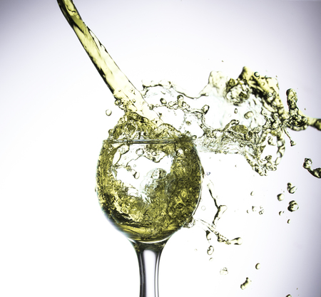 Glass of white wine isolated in white