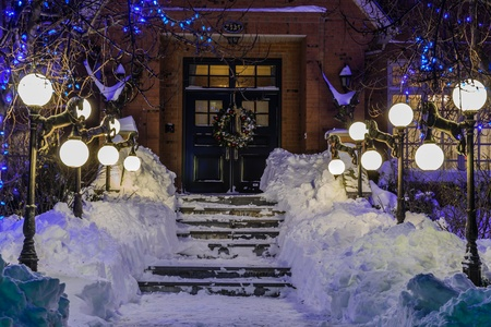 street lamp: A beautiful entrance with lamps of an amazing house in a cold winter night in Quebec, Canadayear; wreath; winter; wall; vertical;