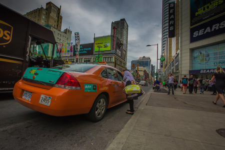 A woman taking a taxi in Toronto city, Canada.