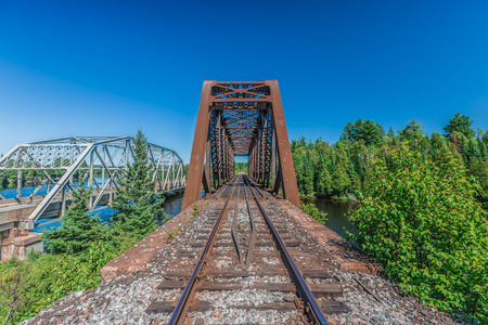 An amazing view of a really long railway on a sunny day. Canada.